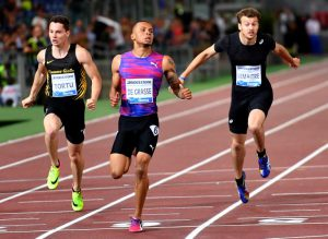 (L-R) Italy's Filippo Tortu, Canada's Andre de Grasse and France's Christophe Lemaitre compete in the men's 200m event at the Rome meeting of the IAAF Diamond League athletics competition at the Olympic Stadium in Rome on June 8, 2017. / AFP PHOTO / ALBERTO PIZZOLI